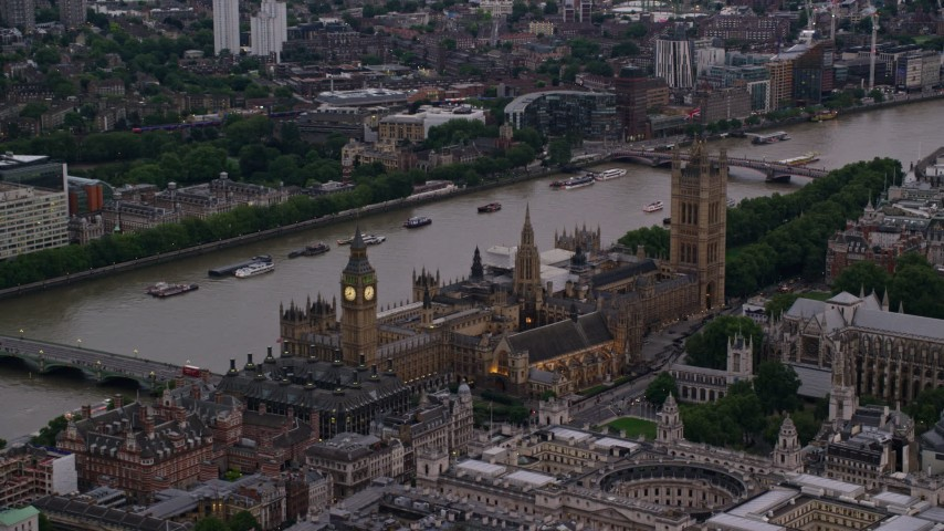 6K stock footage aerial video of Big Ben and British Parliament beside River Thames, London, England, twilight Aerial Stock Footage | AX116_061