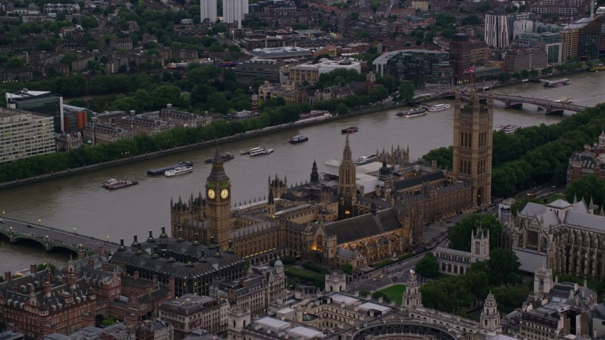 6K aerial video of passing by Big Ben and British Parliament overlooking River Thames, London, England, twilight Aerial Stock Footage | AX116_062