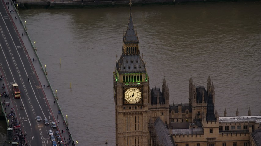 6K stock footage aerial video orbiting Big Ben orbiting River Thames, London England, twilight Aerial Stock Footage | AX116_063