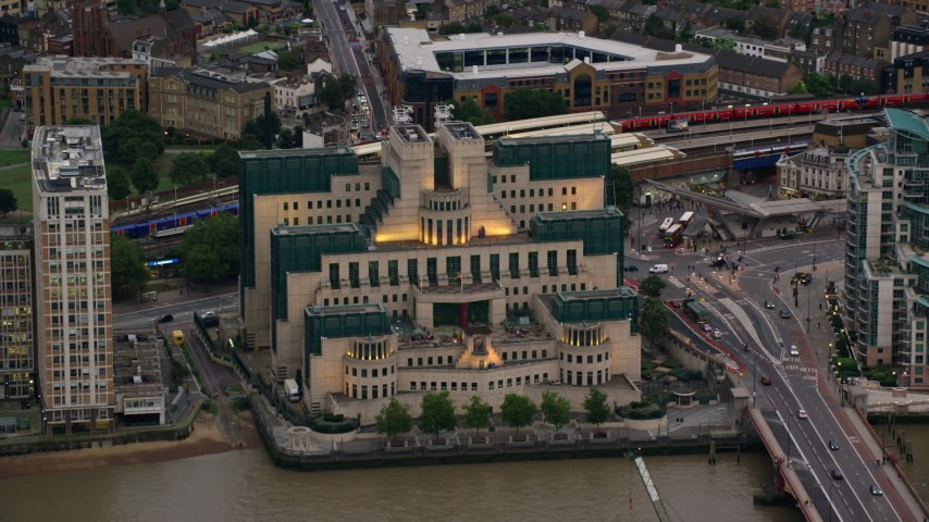 6K stock footage aerial video of flying by MI6 Building by River Thames, London, England, twilight Aerial Stock Footage | AX116_065