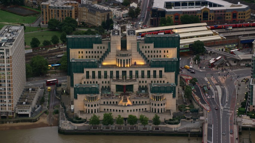 6K stock footage aerial video of the MI6 Building by the River Thames, London, England, twilight Aerial Stock Footage | AX116_066