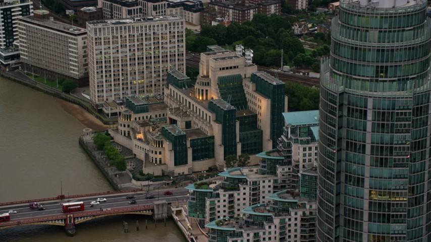6K stock footage aerial video of flying by MI6 Building and St George Wharf Tower, London, England, twilight Aerial Stock Footage | AX116_069