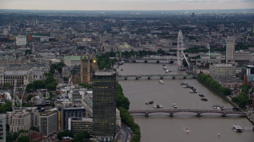 6K stock footage aerial video of Big Ben, London Eye and bridges spanning the River Thames, London, England, twilight Aerial Stock Footage | AX116_070