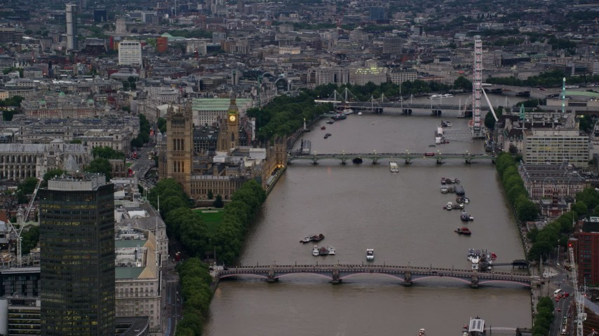 6K stock footage aerial video of Parliament, and bridges spanning the River Thames, London, England, twilight Aerial Stock Footage | AX116_071