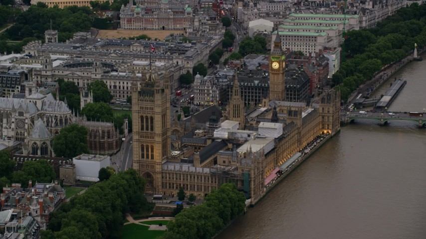 6K stock footage aerial video of approaching Big Ben and British Parliament from River Thames, London, England, twilight Aerial Stock Footage | AX116_073