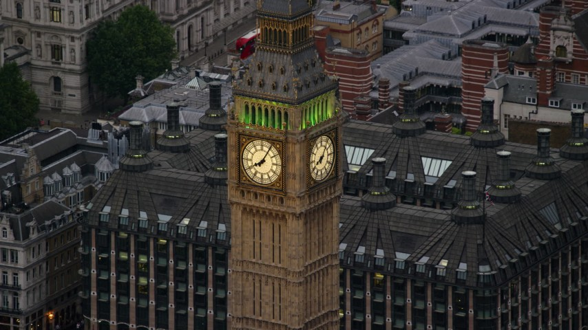 6K stock footage aerial video of flying by Big Ben, London, England, twilight Aerial Stock Footage | AX116_075