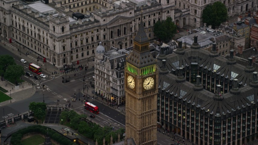 6K stock footage aerial video of flying by famous Big Ben in London, England, twilight Aerial Stock Footage | AX116_076