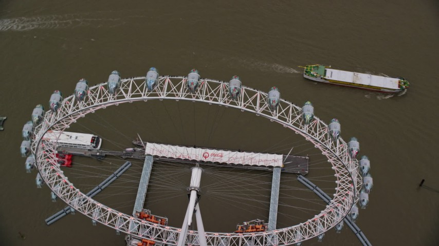 6K stock footage aerial video of orbiting the London Eye on the River Thames, London, England, twilight Aerial Stock Footage | AX116_078