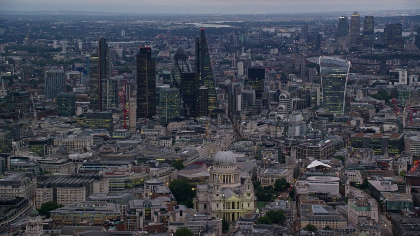 6K stock footage aerial video pan across skyscrapers and Central London cityscape, London, England, twilight Aerial Stock Footage | AX116_081
