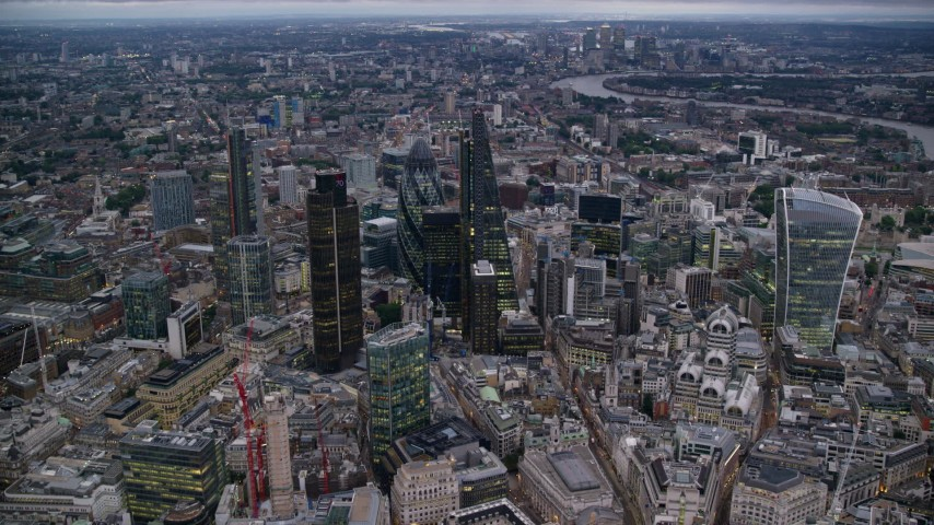 6K stock footage aerial video of flying by skyscrapers in Central London, England, twilight Aerial Stock Footage | AX116_085