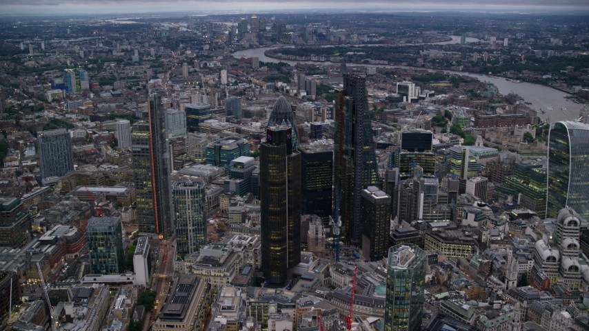 6K stock footage aerial video of orbiting skyscrapers in Central London, England, twilight Aerial Stock Footage | AX116_086