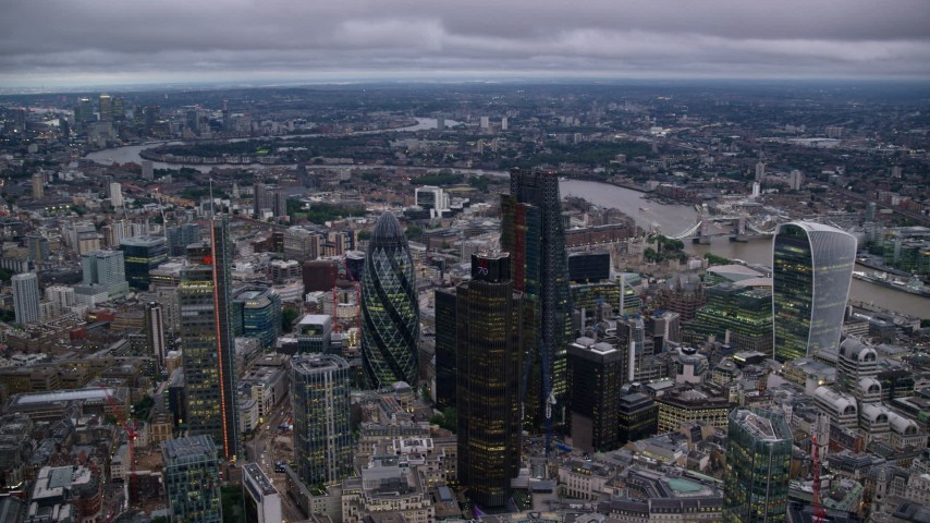 6K stock footage aerial video of an orbit of tall skyscrapers in Central London, England, twilight Aerial Stock Footage | AX116_087