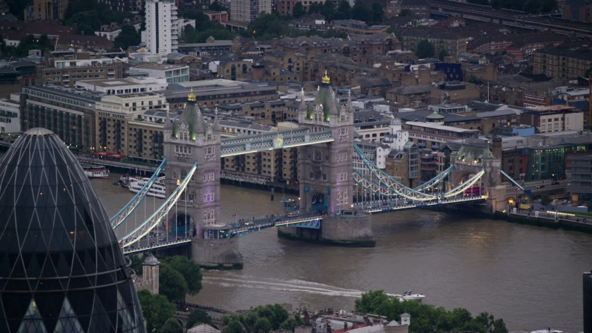 6K stock footage aerial video flyby Tower Bridge spanning River Thames, reveal The Gherkin, London, England, twilight Aerial Stock Footage | AX116_089
