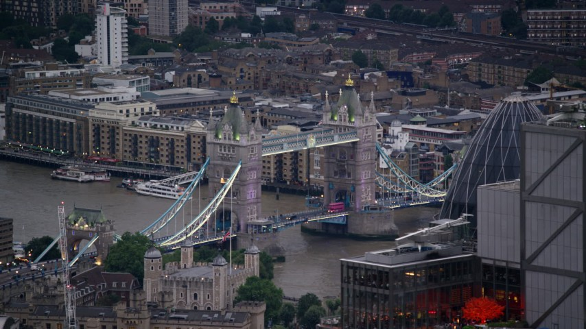 6K stock footage aerial video flyby Heron Tower, revealing Tower Bridge in London, England, twilight Aerial Stock Footage | AX116_090