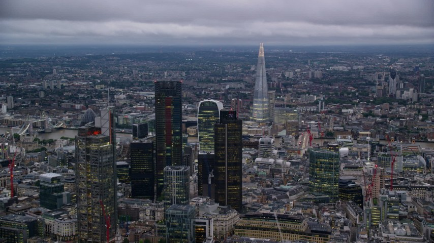 6K stock footage aerial video flyby skyscrapers and cityscape, The Shard in background, London, England, twilight Aerial Stock Footage | AX116_091