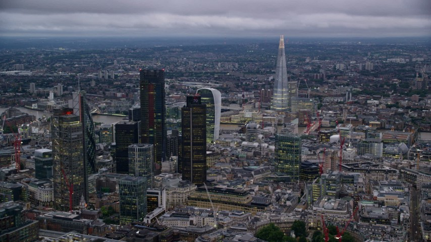 6K stock footage aerial video of skyscrapers and cityscape, with The Shard in background, London, England, twilight Aerial Stock Footage | AX116_092