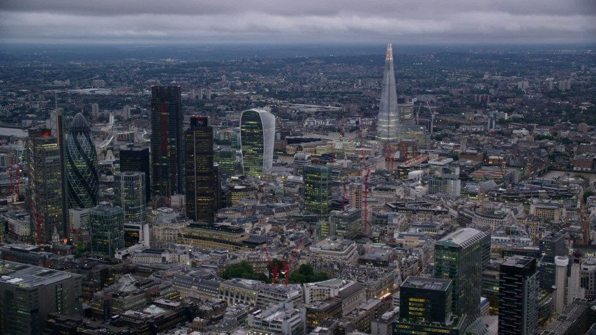 6K stock footage aerial video of a view of skyscrapers and cityscape in London, England, twilight Aerial Stock Footage | AX116_093