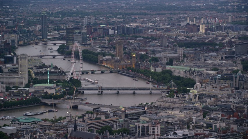 6K stock footage aerial video of London Eye, bridges over River Thames, Big Ben and British Parliament, London, England, twilight Aerial Stock Footage   AX116_094