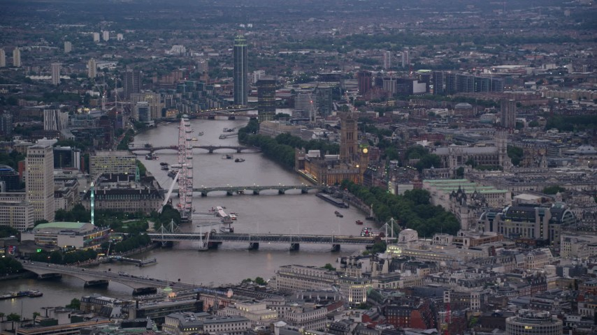 6K aerial video of the London Eye, Big Ben and British Parliament, bridges over River Thames, London, England, twilight Aerial Stock Footage | AX116_095