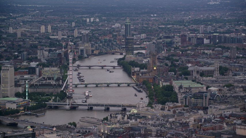 6K stock footage aerial video of London Eye and bridges over River Thames, Big Ben and British Parliament, London, England, twilight Aerial Stock Footage | AX116_096