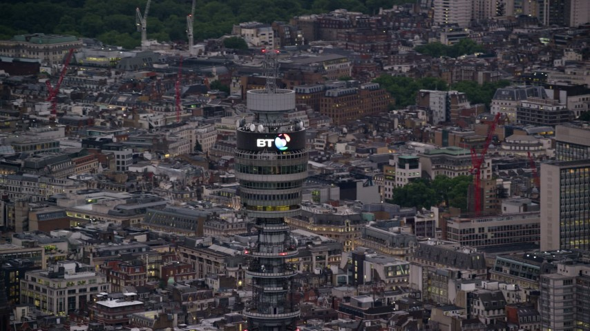 6K stock footage aerial video of an orbit of the top of BT Tower, London, England, twilight Aerial Stock Footage | AX116_098