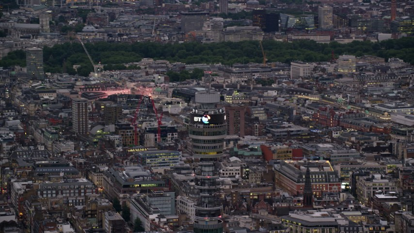 6K stock footage aerial video of circling the top of BT Tower, London, England, twilight Aerial Stock Footage | AX116_099