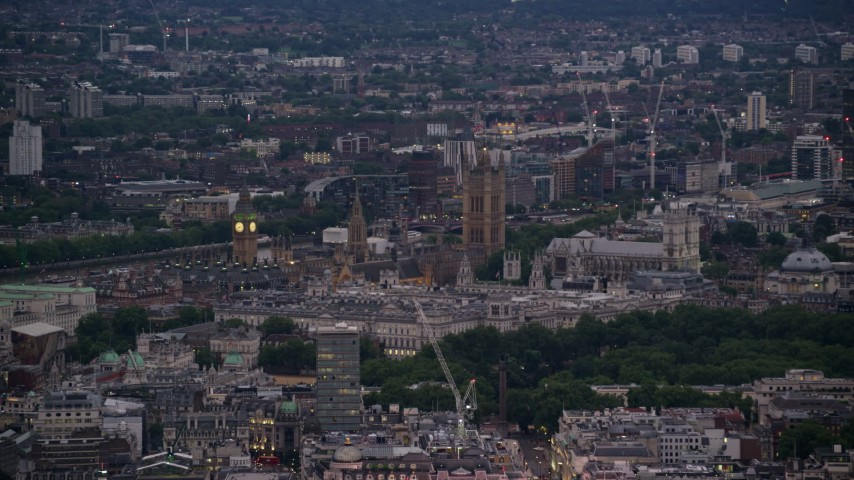 6K stock footage aerial video of flying by Big Ben, Parliament, and Westminster Abbey in London, England, night Aerial Stock Footage | AX116_100