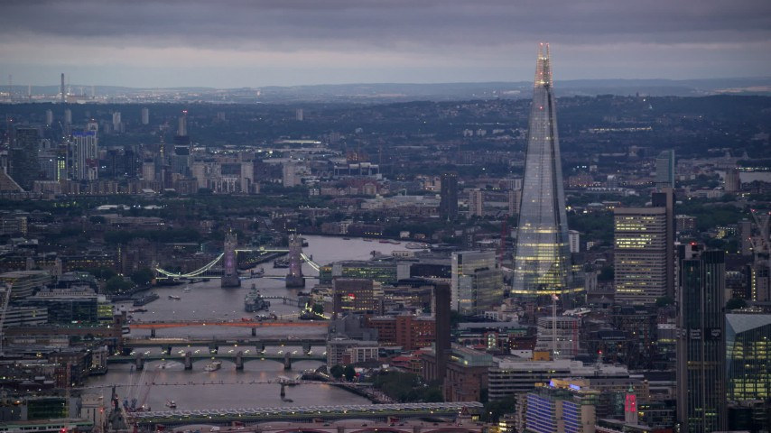 6K stock footage aerial video of Tower Bridge spanning River Thames near The Shard, London, England, night Aerial Stock Footage | AX116_103