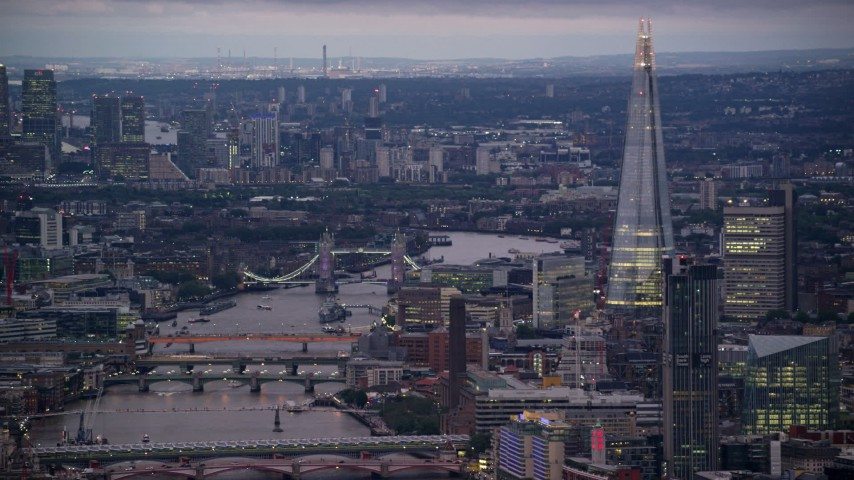 6K stock footage aerial video of a view of the Tower Bridge over River Thames near The Shard, London, England, night Aerial Stock Footage | AX116_104