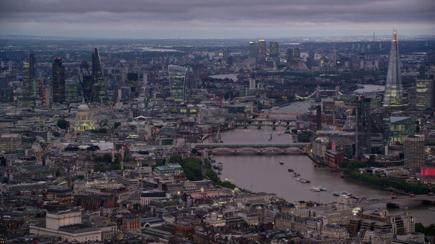 6K stock footage aerial video of bridges spanning River Thames near skyscrapers, London, England, night Aerial Stock Footage | AX116_105