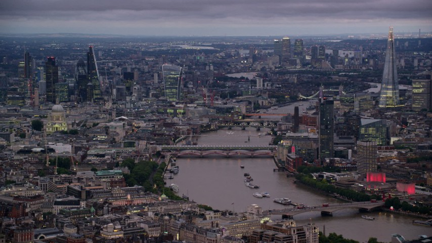 6K stock footage aerial video flyby bridges spanning River Thames, skyscrapers and cityscape, London, England, night Aerial Stock Footage | AX116_106
