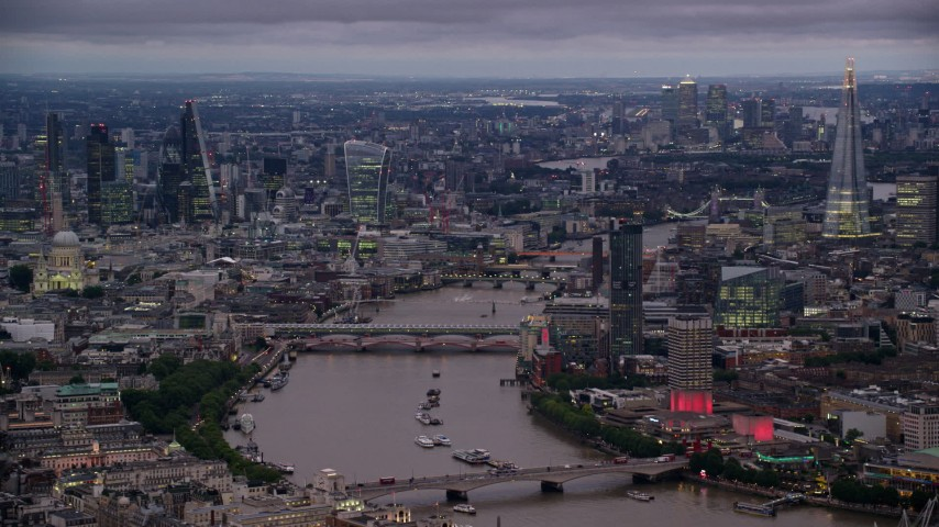 6K stock footage aerial video of bridges over River Thames, skyscrapers and cityscape, London, England, night Aerial Stock Footage | AX116_107