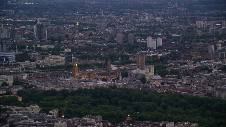 6K stock footage aerial video of flying by Big Ben and the British Parliament in London, England, night Aerial Stock Footage | AX116_109