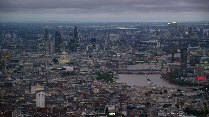 6K stock footage aerial video of skyscrapers and vast cityscape near bridges over River Thames, London, England, night Aerial Stock Footage | AX116_110