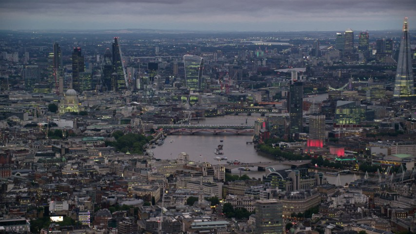 6K stock footage aerial video of bridges spanning River Thames between skyscrapers, London, England, night Aerial Stock Footage | AX116_111