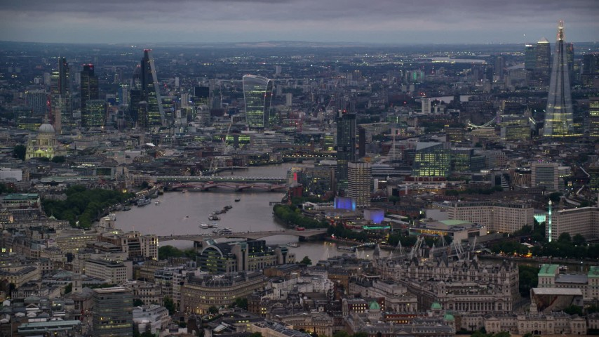 6K stock footage aerial video of towering skyscrapers and bridges spanning River Thames, London, England, night Aerial Stock Footage | AX116_112