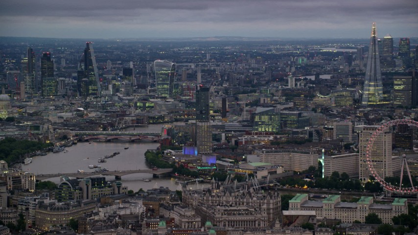 6K aerial video tall skyscrapers and River Thames bridges, reveal London Eye, London, England, night Aerial Stock Footage | AX116_113