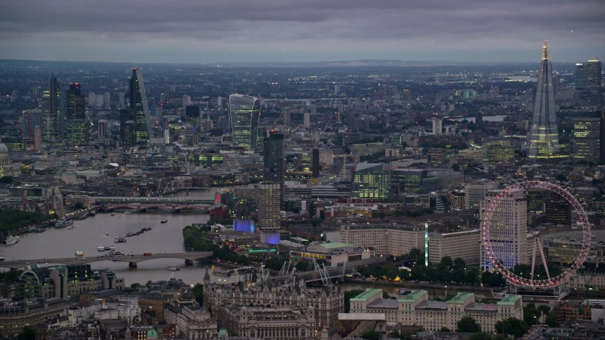 6K stock footage aerial video of skyscrapers, and River Thames bridges seen from London Eye, London, England, night Aerial Stock Footage | AX116_114