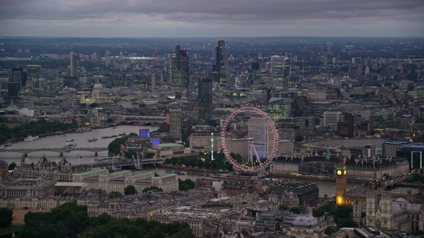 6K stock footage aerial video of vast cityscape seen from London Eye and Big Ben by River Thames, London, England, night Aerial Stock Footage | AX116_116