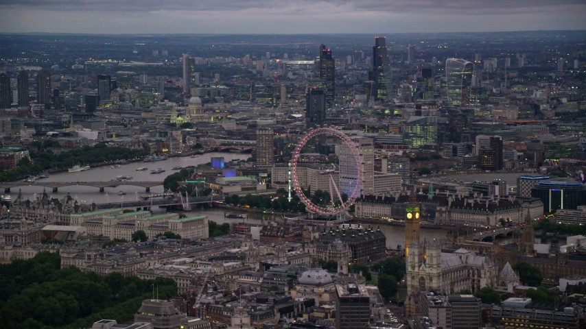 6K stock footage aerial video of London Eye, Big Ben and the British Parliament, London, England, night Aerial Stock Footage   AX116_117