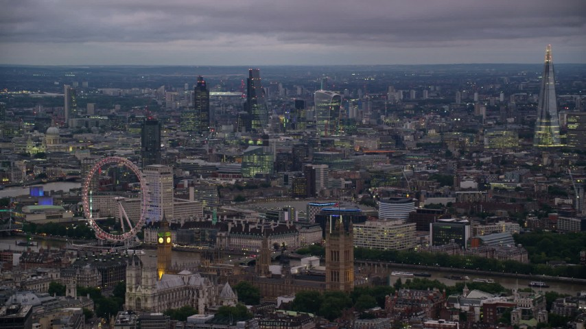 6K stock footage aerial video passing London Eye, Big Ben and British Parliament by River Thames, London, England, night Aerial Stock Footage | AX116_118