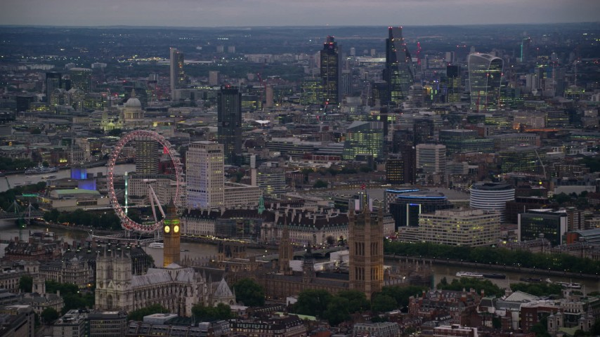 6K stock footage aerial video passing London Eye, Big Ben and British Parliament, London, England, night Aerial Stock Footage | AX116_119