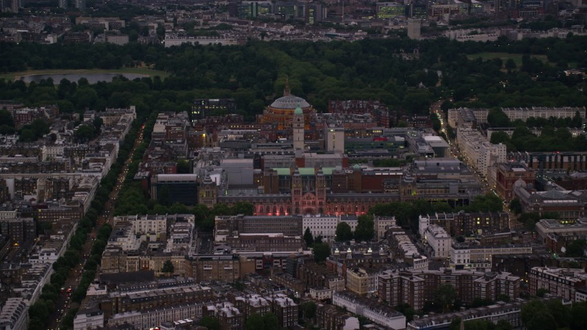 6K stock footage aerial video of Royal Albert Hall, Queen's Tower, and Natural History Museum, London, England, night Aerial Stock Footage AX116_126