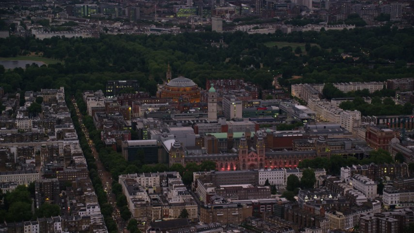 6K stock footage aerial video flyby Royal Albert Hall, Queen's Tower, Natural History Museum in London, England, night Aerial Stock Footage | AX116_127