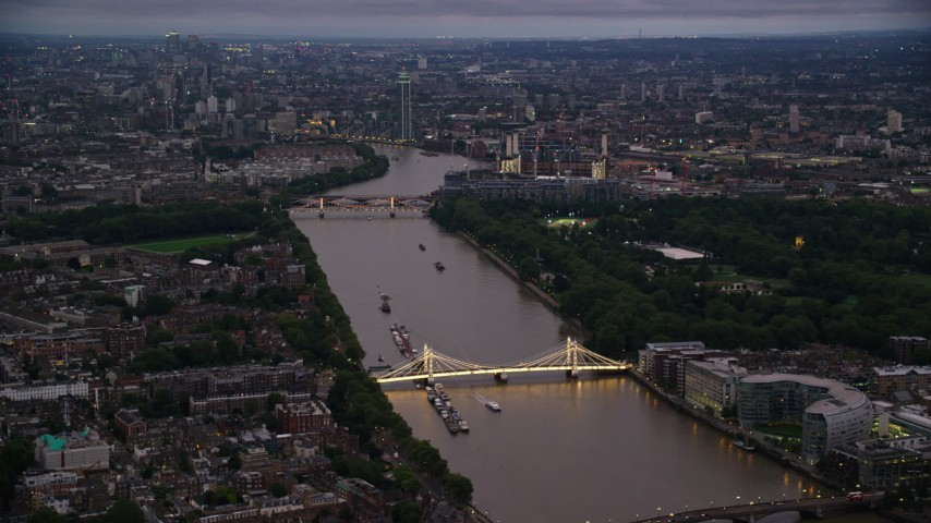 6K stock footage aerial video of the London cityscape seen from Albert Bridge and River Thames, England, night Aerial Stock Footage | AX116_128