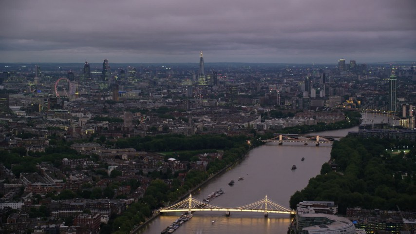 6K stock footage aerial video wide view of London cityscape and River Thames seen from Albert Bridge, London, England, night Aerial Stock Footage | AX116_130