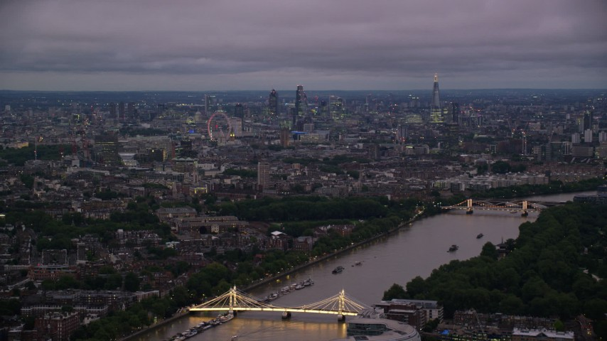 6K stock footage aerial video wide view of London from River Thames and Albert Bridge, England, night Aerial Stock Footage | AX116_131