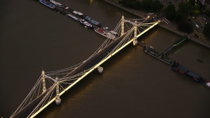 6K stock footage aerial video orbit the Albert Bridge spanning River Thames in London, England, night Aerial Stock Footage | AX116_136