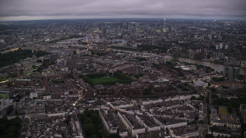 6K stock footage aerial video approach Big Ben, British Parliament, London Eye and River Thames, London, England, night Aerial Stock Footage | AX116_138