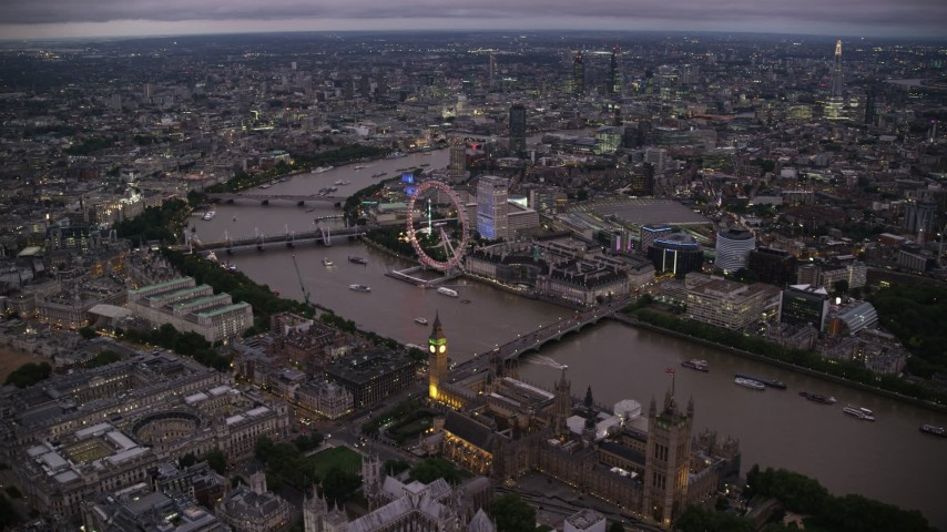 6K stock footage aerial video of fly over Big Ben, British Parliament and Westminster Abbey toward London Eye, England, night Aerial Stock Footage | AX116_142